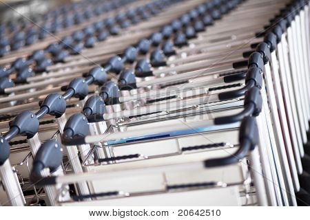 Lined Up Trolleys At Airport