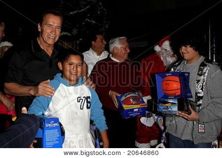 LOS ANGELES - DEC 19: Arnold Schwarzenegger greets fans at the Hollenbeck Youth Center's 28th