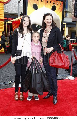 LOS ANGELES - MAY 22:  Mimi Rogers, daughter Lucy, son Charlie at the premiere of Kung Fu Panda 2 at the Grauman's Chinese Theater in Los Angeles, California on May 22, 2011.