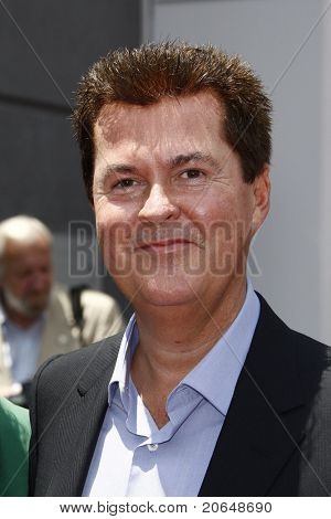 LOS ANGELES - MAY 23: Simon Fuller at a ceremony where Simon Fuller receives a star on the Hollywood Walk of Fame in Los Angeles, California on May 23, 2011.
