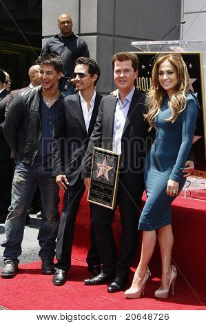LOS ANGELES - MAY 23: Marc Anthony, Simon Fuller, Jennifer Lopez at a ceremony where Simon Fuller receives a star on the Hollywood Walk of Fame in Los Angeles, California on May 23, 2011.