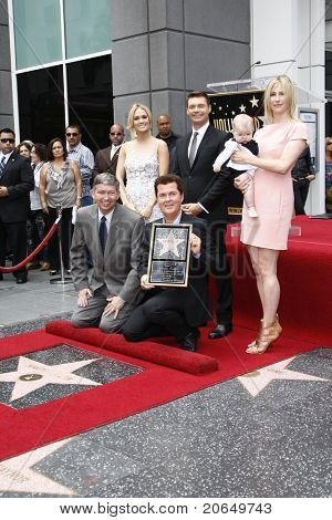 LOS ANGELES - MAY 23: Carrie Underwood, Simon Fuller, his wife, daughter, Ryan Seacrest, Leron Gubler as Simon Fuller receives a star on the Hollywood Walk of Fame in Los Angeles, CA on May 23, 2011.