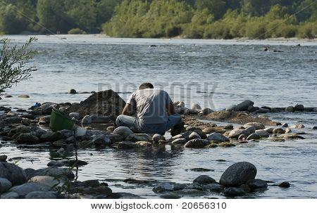 Man Gold Panning At A Creek