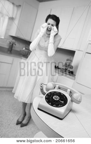 Woman Weeps By The Telephone