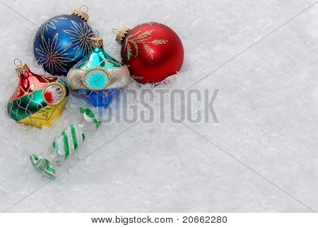 Christmas ornaments on snow