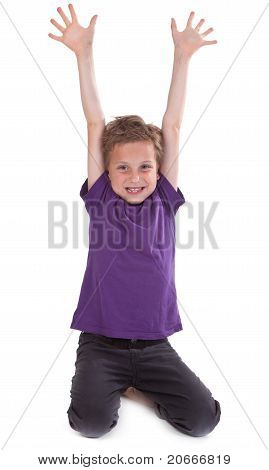 Happy Young Boy With Hands Raised