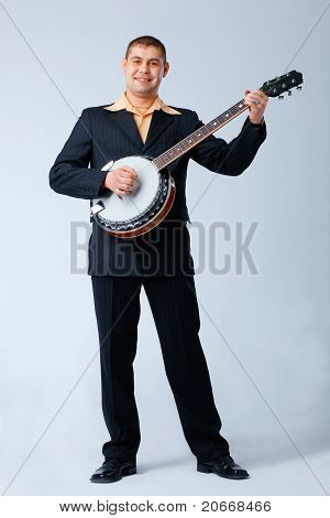 Man Is Playing On Banjo.