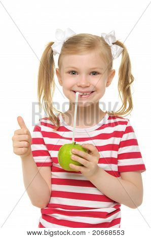Girl drinking apple juice through straw