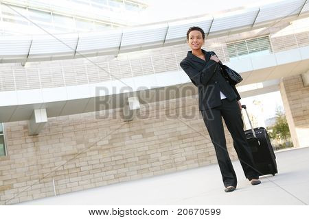 A pretty african american business woman traveling