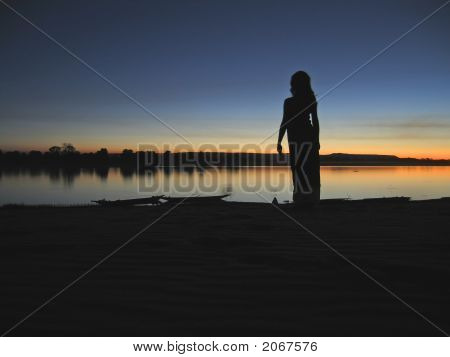 Sundown On The Tsiribihina River With A Outline Woman  Silhouette, Madagascar