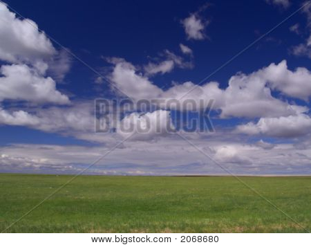 Clouds And Grassland