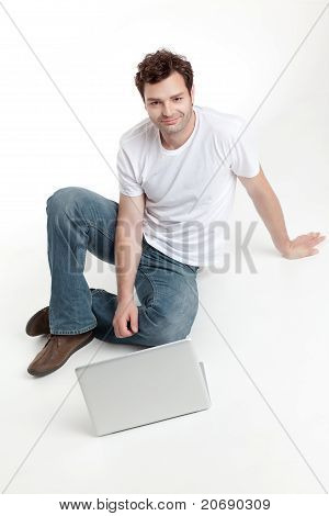 Man Sitting Behind Blanck Laptop Smiling