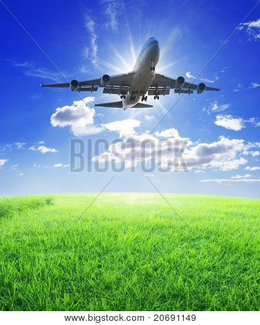 Airplane fly over grass
