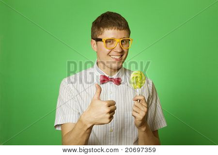 Young man with a lollipop