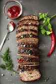 Tasty sliced turkey meatloaf on baking tray poster