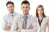 Business team isolated on white. Portrait of happy young business people in team. Business team lead poster