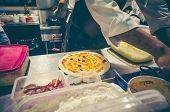 Chef In White Uniform Preparing Delicious Pizza At Kitchen. poster