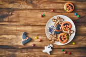 Happy Halloween! Sweets and cookies on the table in the home. Preparation for holiday. poster