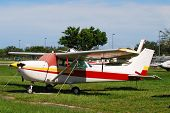 foto of cessna  - Private propeller cessna airplane parked on airport grass - JPG
