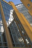 Office Building At An Angle With Reflection Of Clouds poster