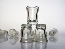 image of shot glasses  - small glasses over white - JPG