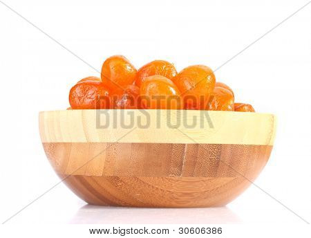 Dried tangerines in wooden bowl isolated on white