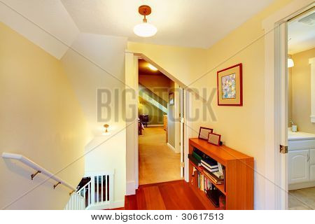 Yellow Low Ceiling Home Hallway With Staircase Interior.