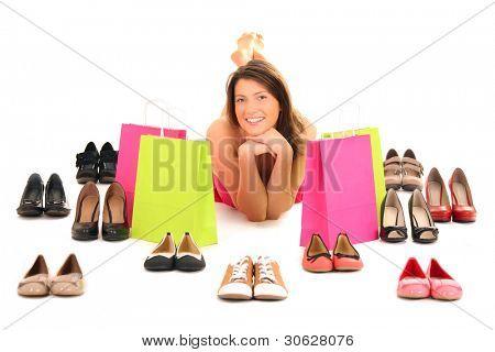 ein Bild von eine hübsche junge Frau liegend unter Schuhe over white background