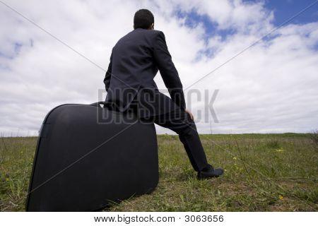 Businessman Sit In His Baggage