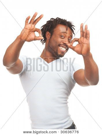 Portrait of happy african-american man showing ok sign and smiling, over white background