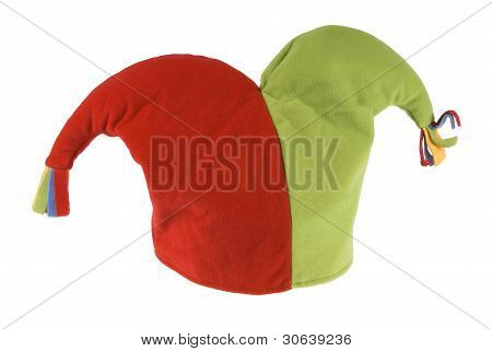 Red and green jester hat isolated on a white background.
