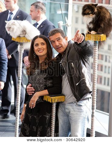 MOSCOW - JULY 16: Antonio Banderas and Salma Hayek arriving at the