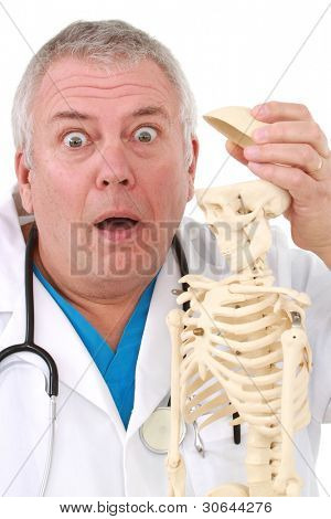 Curious doctor looking into a skull