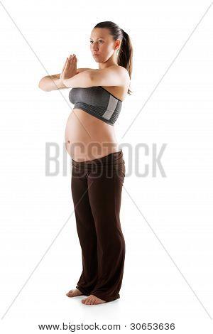 Beautiful pregnant woman doing exercises