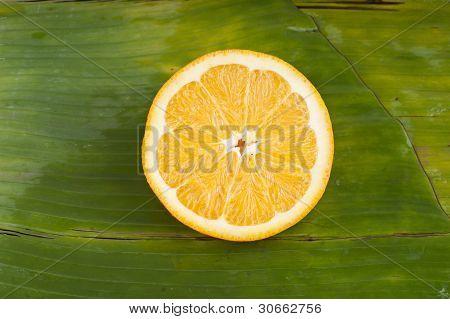 delicious sweet fresh cut orange on banana leaf