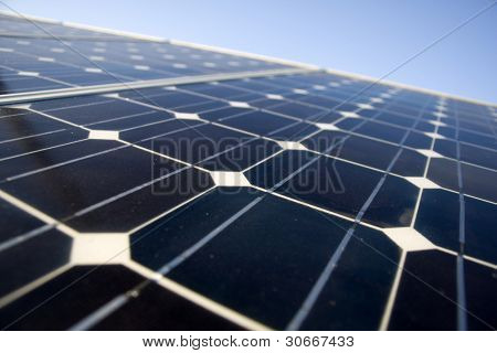 Texture detail of photoelectric cells of a solar panel (Blue and ecology energy) - photographed with shallow DOF