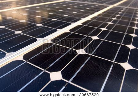 Texture detail of photoelectric cells of a solar panel (Blue and ecology energy). Photographed with shallow DOF