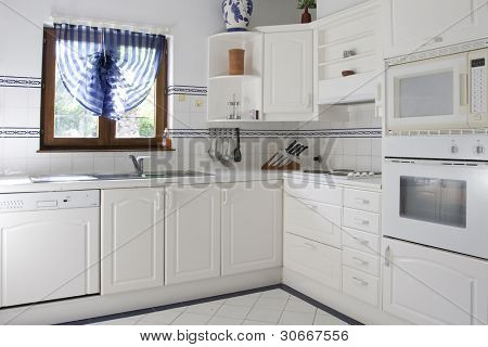 Classic kitchen with white wood and white tile