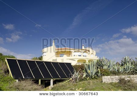 Villa with photocell boards at Algarve on a sunny day, south of Portugal