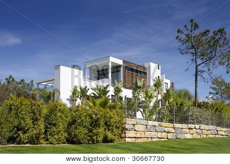 Beautiful villa with a healthy garden at Algarve on a sunny day (Quinta do Lago, Portugal)