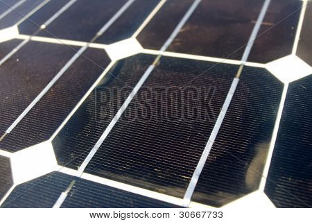 Closeup texture photoelectric cells from a solar panel (Blue and ecology energy)