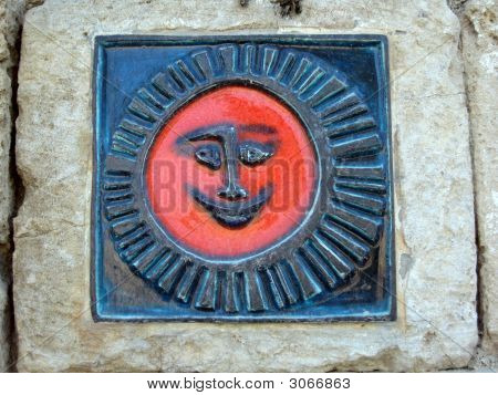 Detail Of A Stone Sun Figure On Wall