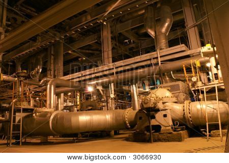 Pipes, Machinery, Tubes And Pumps At A Power Plant