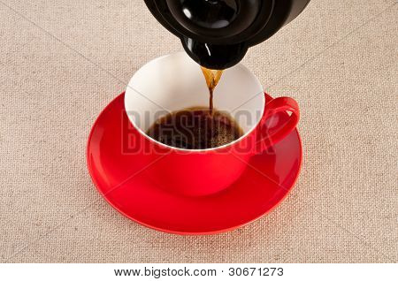 Expresso Being Poured Into A Red Coffee Cup
