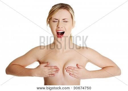 Gorgeous topless blonde female covering her breast and screaming
