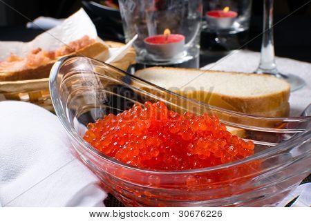 Red caviar in a glass plate