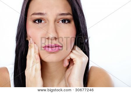 beautiful  young woman having tooth pain