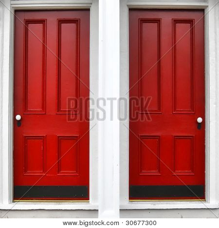 Twin Red Wood Panel Entry Door On Historic Home