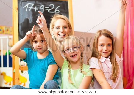Family - mother with her daughters at home, all of them going to school already