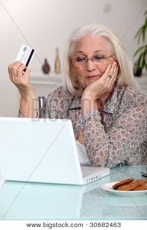 Elderly woman shopping on-line